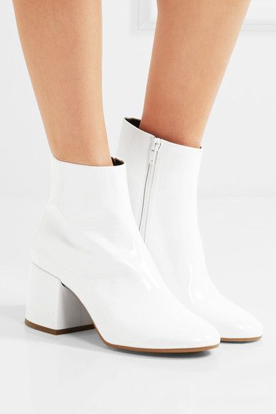 Heel measures approximately 65mm/ 2.5 inches White patent-leather .