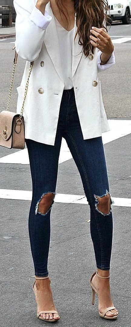 winter #outfits white blazer, distressed blue skinny jeans and .