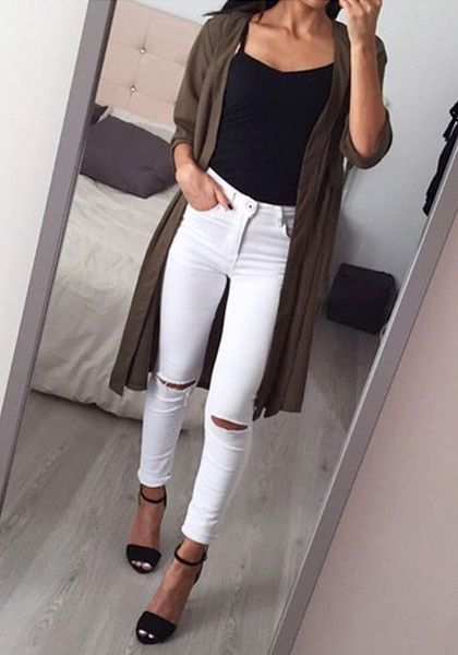 This classic white ripped skinny jeans is styled with distressed .
