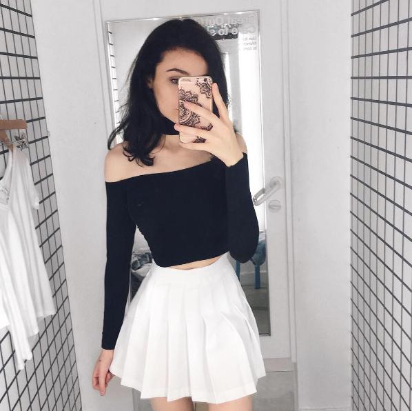 sh1mxx wears the Tennis Skirt + Mid Length Chocker Top. | White .